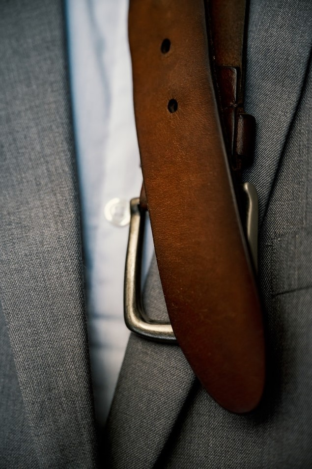 brown belt and suit